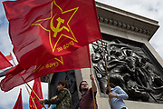 Members of the Communist Party of Great Britain gather on the plinth below Nelsons Column in Trafalgar Square during the traditional May Day celebrations in the capital, on 1st May 2018, in London, England.