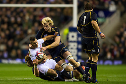 England Scrum-Half (#9) Ben Youngs (Leicester) is tackled by Scotland Lock (#4) Richie Gray (Sale Sharks) during the second half of the match - Photo mandatory by-line: Rogan Thomson/JMP - Tel: Mobile: 07966 386802 02/02/2013 - SPORT - RUGBY UNION - Twickenham Stadium - London. England v Scotland - 2013 RBS Six Nations Championship. The winner of this fixture is awarded the Calcutta Cup.