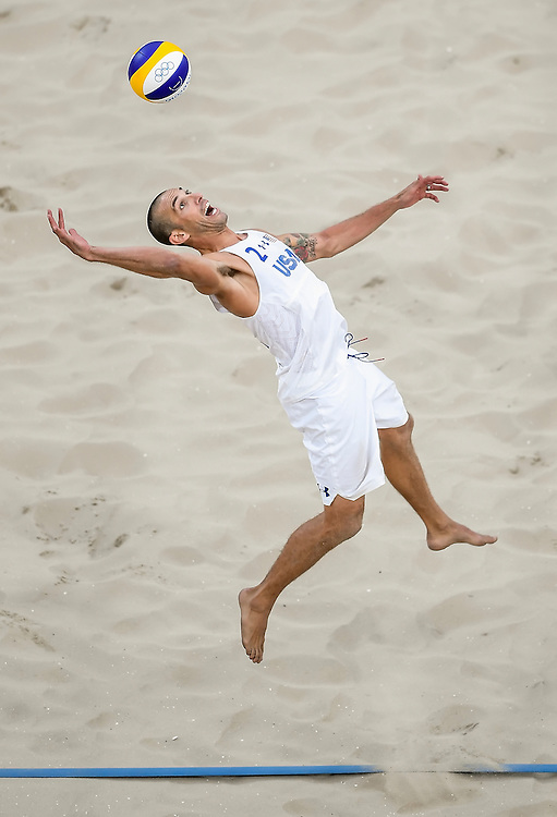 United States beach volleyball player Nicholas Lucena lept during a return on Monday in the quarterfinal loss to Brazil at the Olympic Stadium during the 2016 Summer Olympics Games in Rio de Janeiro, Brazil. Lucena and his partner Phil Dalhausser lost two sets to one to end their Olympic tournament.