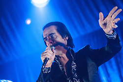 A shadow forms on the face of Nick Cave, of Nick Cave and the Bad Seeds, on stage tonight at The Barrowlands, Glasgow, Scotland.<br /> ©Michael Schofield.