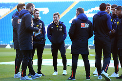 Bournemouth's Ryan Fraser (centre) speaks with teammates ahead of the match during the Premier League match at the Cardiff City Stadium.