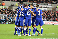 Diego Costa of Chelsea (19) celebrates with his teammates after he scores his teams 2nd goal. Barclays Premier League match, Swansea city v Chelsea at the Liberty Stadium in Swansea, South Wales on Saturday 17th Jan 2015.<br /> pic by Andrew Orchard, Andrew Orchard sports photography.