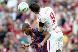 26.07.2011, Allianz Arena, Muenchen, GER, Audi Cup 2011,  FC Barcelona vs SC Internacional de Porto Alegre, im Bild Seydou Keita (Barcelona #15) unterligt im kopfballduell gegen Leandro Damiao (Internacional #9)  // during the Audi Cup 2011,  FC Barcelona vs SC Internacional de Porto Alegre , on 2011/07/26, Allianz Arena, Munich, Germany, EXPA Pictures © 2011, PhotoCredit: EXPA/ nph/  Straubmeier       ****** out of GER / CRO  / BEL ******