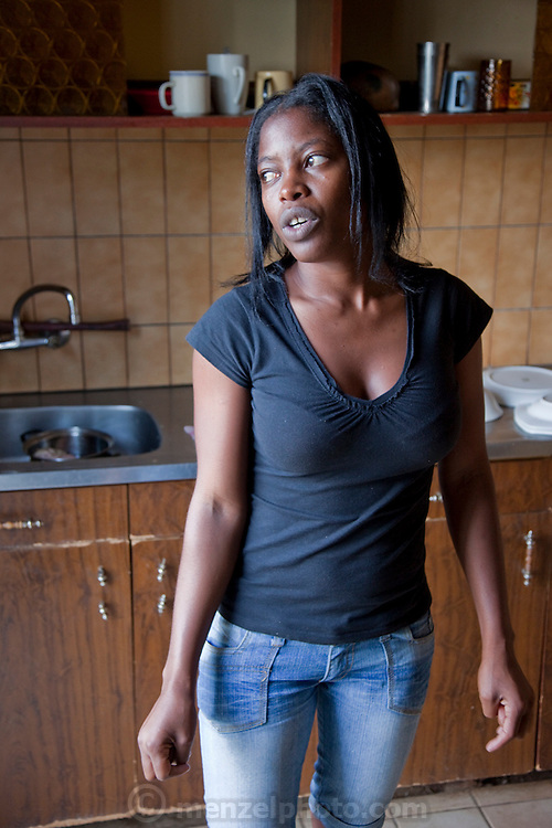 Mestilde Shigwedha, a diamond polisher for NamCot Diamonds in Windhoek, Namibia, in the kitchen of her rented house after a busy day at the factory. (Mestilde Shigwedha was featured in the book What I Eat: Around the World in 80 Diets.) MODEL RELEASED.