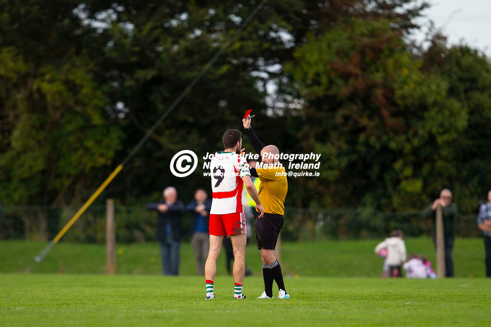 29/09/2019, JFC Quarter Final at Kilmainham GFC, Kells.<br /> Gaeil Colmcille vs Dunsany<br /> Referee - Keith Sheerin shows the red card to Gaeil Colmcille`s Philip Ward <br /> Photo: David Mullen / www.quirke.ie ©John Quirke Photography, Unit 17, Blackcastle Shopping Cte. Navan. Co. Meath. 046-9079044 / 087-2579454.<br /> ISO: 500; Shutter: 1/1250; Aperture: 3.2; <br /> File Size: 2.4MB