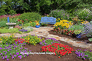 63821-21717 Blue bench, blue pots, butterfly house, bird bath and stone path in flower garden.  Black-eyed Susans (Rudbeckia hirta) Red Dragon Wing Begonias (Begonia x hybrida)  Homestead Purple Verbena (Verbena canadensis), Red Verbena, New Gold Lantana (Lantana camara) Butterfly Bushes, Russian Sage (Perovskia atriplicifolia),  Marion Co., IL