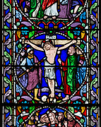 Stained glass window crucifixion of Jesus Christ, by William Wailes dated 1860, Bishops Cannings church, Wiltshire, England, UK