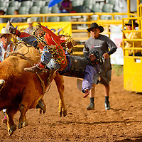 090513  Adron Gardner/Independent<br /> <br /> Darrick Burbank floats off his bull ride but not before scoring a 69-point ride in the Navajo Nation Fair rodeo in Window Rock Thursday.