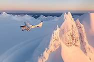 A Homer Air cessna 206 flies over the glaciers, ice fields and rugged peaks of the Kenai Mountain Rage during a flightsee from Homer, Alaska.