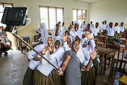 At the end of the final class Bharat Thakrar poses for a selfie with students she has been working with for 6 weeks at Angaza school. Part of the VSO / ICS Elimu Fursa project (Opportunities in Education) Lindi, Lindi region. Tanzania.