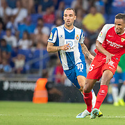 BARCELONA, SPAIN - August 18:  Fernando #25 of Sevilla passes the ball watched by Sergi Darder #10 of Espanyol during the Espanyol V  Sevilla FC, La Liga regular season match at RCDE Stadium on August 18th 2019 in Barcelona, Spain. (Photo by Tim Clayton/Corbis via Getty Images)