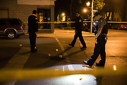May 25, 2017 - Chicago, IL, USA - Police work the scene where a 14-year-old boy and 17-year-old boy were shot near the intersection of 25th Street and Trumbull Avenue Thursday, May 25, 2017 in Chicago. (Credit Image: © Armando L. Sanchez/TNS via ZUMA Wire)