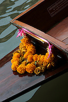 Longtail Boat Garland - In Bangkok, the Chao Phraya is a major transportation artery for a vast network of ferries and water taxis, also known as longtails. More than 15 boat lines operate on the river and canals of the city, including commuter ferry lines.