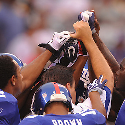 21 Aug, 2010: New York Giants receivers lift their hands together during warmups for NFL preseason action between the New York Giants and Pittsburgh Steelers at New Meadowlands Stadium in East Rutherford, New Jersey.