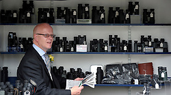 © Licensed to London News Pictures. 21/06/2012. Ascot, UK A man sells binoculars. Ladies Day at Royal Ascot 21st June 2012. Royal Ascot has established itself as a national institution and the centrepiece of the British social calendar as well as being a stage for the best racehorses in the world.. Photo credit : Stephen Simpson/LNP