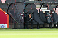 Football - 2020 / 2021 EFL Championship - AFC Bournemouth vs. Blackburn Rovers<br /> <br /> Bournemouth's Manager Jason Tindall takes a quick phone call before the during the pre match warm up at the Vitality Stadium (Dean Court) Bournemouth <br /> <br /> COLORSPORT/SHAUN BOGGUST