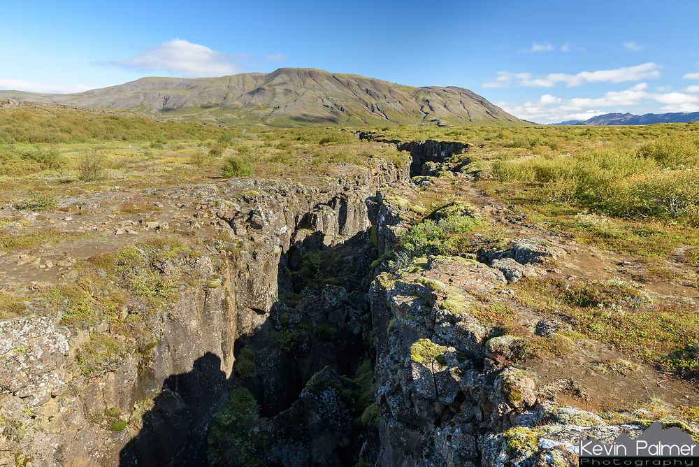 There are lots of rifts like this one in Þingvellir National Park. It is here where the North American and Eurasian tectonic plates meet. The plates are moving apart at about 3mm per year.