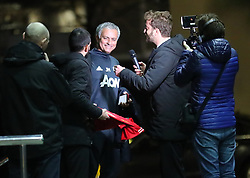 """Manchester United Manager Jose Mourinho is ambushed by reporters from Italian TV as he arrives back at The Lowry Hotel on Wednesday evening. Alessandro Onnis and Stefano Corti from the show """"Le iene on Italian Tv Channel """"Italia 1 jumped out of their car and ran up the steps of The Lowry Hotel at about 5.15pm and started asking Mourinho questions and he seemed happy enought to talk. When the interview ended they asked Mourinho to sign a Man United shirt, which he did. They then turned the shirt over to reveal that No1 Antonio Conte written on it. Mourinho took the gag in good spirits and walked into the hotel."""