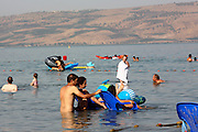 Israel, Lower Galilees, Summer Vacation at the Sea of Galilee people cool of in the lake