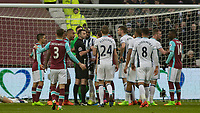 Football - 2016 / 2017 Premier League - West Ham United vs. West Bromwich Albion<br /> <br /> Players surround the referee Michael Oliver after a West Ham goal was disallowed at the London Stadium.<br /> <br /> COLORSPORT/DANIEL BEARHAM