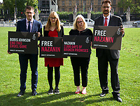 David Linden MP, Cat Smith MP, Emma Lewell-Buck MPAND  Afzal Khan MP  At the  photocall the  took place in Parliament Square to mark Nazanin Zaghari-Ratcliffe's 2000th day of being detained in Iran, A giant snakes and ladders board was used to show the ups and downs of Nazanin's case photo by Leigh Bruin
