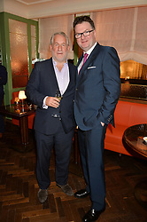 Left to right, SIMON KELNER and EWAN VENTERS at a party hosted by Pace Gallery as part of Frieze 2015 held at 45 Jermyn Street, London on 15th October 2015.