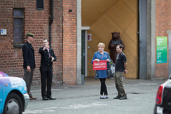 © Licensed to London News Pictures . 30/07/2016 . Liverpool , UK . People looking for an Owen Smith rally are redirected to a field off Bridgewater Street in Liverpool after the booked venue , the Camp and Furnace warehouse (pictured behind) , reportedly cancelled the booking . Smith is campaigning to replace Jeremy Corbyn as the leader of the Labour Party . Photo credit : Joel Goodman/LNP