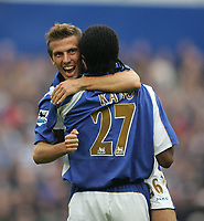 Photo: Lee Earle.<br /> Portsmouth v Reading. The Barclays Premiership. 28/10/2006. Portsmouth's Gary O'Neil (L) congratulates Kanu after he scored their second.