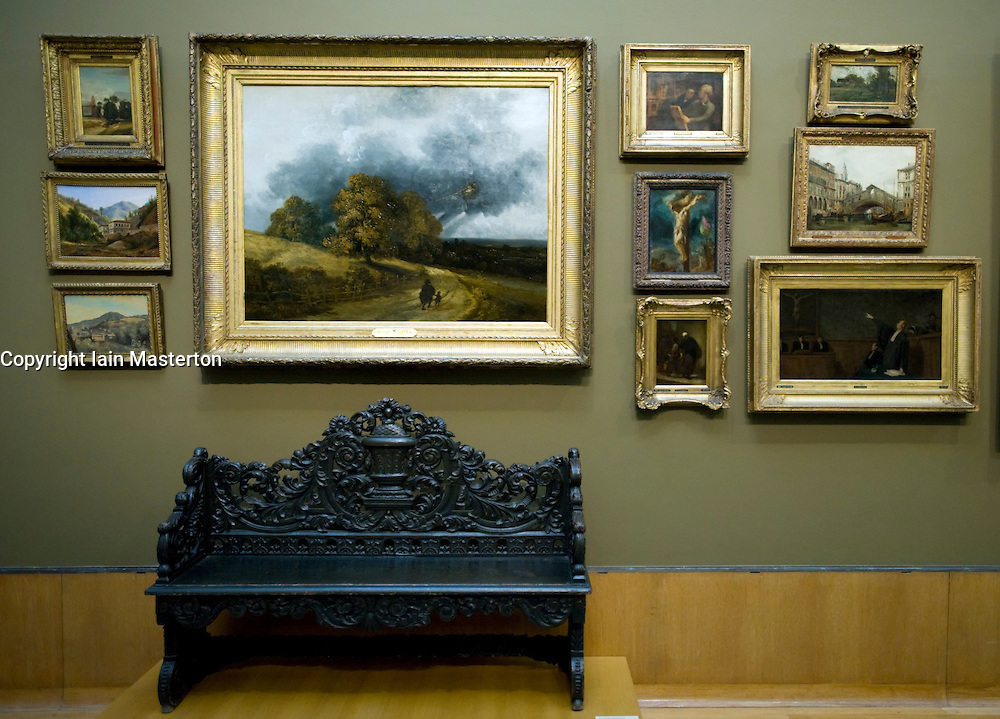 Oil paintings hanging together in Salon gallery at Museum Boijmans Van Beuningen in Rotterdam Netherlands 2008