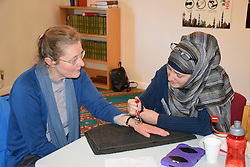 Norwich, UK, 11 November 2017. Open Day at the Rose Lane Mosque, Norwich. Revd Dr Fiona Haworth from The CHurch of St Peter Mancroft in Norwich having a henna tattoo painted on her hand. This communal event allows the wider community to visit and learn about Islam and the way of life of 5% of the UK population. Credit Liz Somerville/Alamy Live News