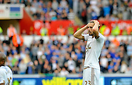Gylfi Sigurdsson of Swansea City reacts shortly before going off in the second half.<br /> Barclays Premier League match, Swansea city v Everton at the Liberty Stadium in Swansea, South Wales on Saturday 19th September 2015.<br /> pic by Phil Rees, Andrew Orchard sports photography.