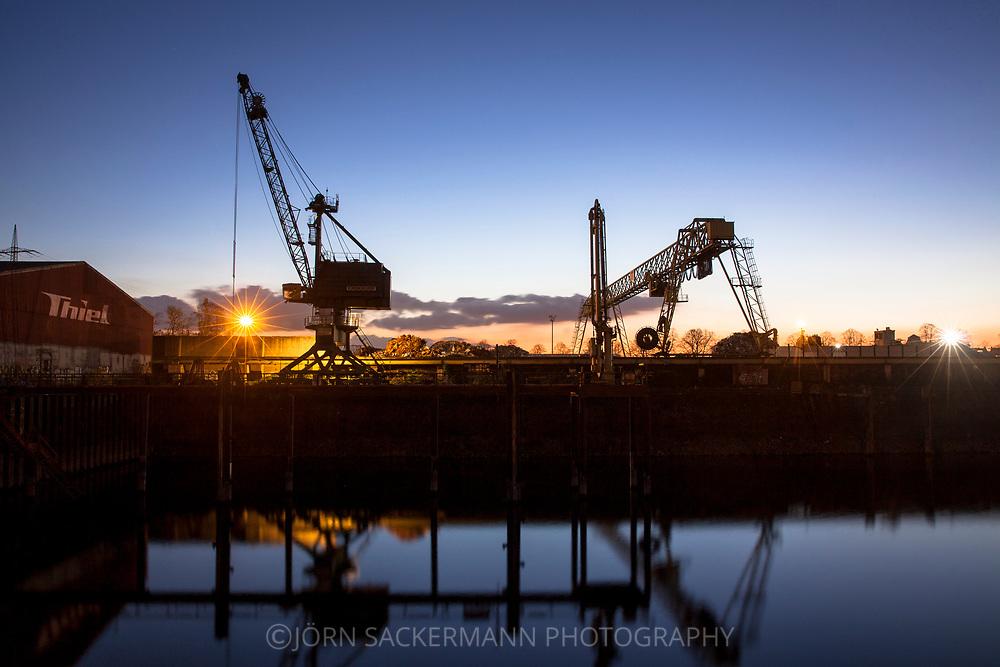 cranes in the Rhine harbor in the district Deutz, Cologne, Germany.<br /> <br /> Verladekraene im Deutzer Hafen, Koeln, Deutschland.