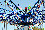 The central mechanism of a swings ride at a carnival, Blue Hill, Maine.