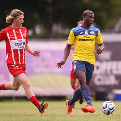 BRISBANE, AUSTRALIA - MARCH 4: Kimba Kibombo of Thunder passes the ball under pressure from Jez Lofthouse of Olympic during the NPL Queensland Senior Mens Round 5 match between Olympic FC and SWQ Thunder at Goodwin Park on March 4, 2017 in Brisbane, Australia. (Photo by Patrick Kearney/Olympic FC)