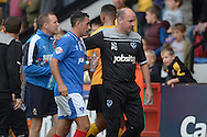 Paul Cook, the Portsmouth manager escorts Gary Roberts of Portsmouth into the tunnel after the half time whistle. Skybet football league two match, Cambridge Utd v Portsmouth at the Abbey Stadium  in Cambridge on Saturday 10th October 2015.<br /> pic by John Patrick Fletcher, Andrew Orchard sports photography.