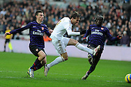 Swansea city's Michu shoots and scores the 1st goal. FA cup with Budweiser, 3rd round match, Swansea city v Arsenal at the Liberty Stadium in Swansea, South Wales on Sunday  6th Jan 2013. pic by Andrew Orchard, Andrew Orchard sports photography,