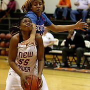 New Hanover's Nyasia Waddell shoots past Ksyia Sellers. (Jason A. Frizzelle)