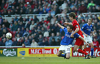 Photo. Andrew Unwin.<br /> Middlesbrough v Leicester City, Barclaycard Premier League, Riverside Stadium, Middlesbrough 17/01/2004.<br /> Leicester's Paul Dickov (l) is held back by Middlesbrough's Chris Riggott (r).