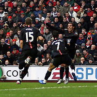 Photo: Mark Stephenson/Sportsbeat Images.<br /> Liverpool v Manchester United. The FA Barclays Premiership. 16/12/2007.Carlos Tevez celebrates his goal with team mates
