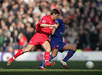 Photo: Lee Earle.<br /> Liverpool v Manchester United. The FA Cup. 18/02/2006. Liverpool's Steven Gerrard (L) battles with Mikael Silvestre.