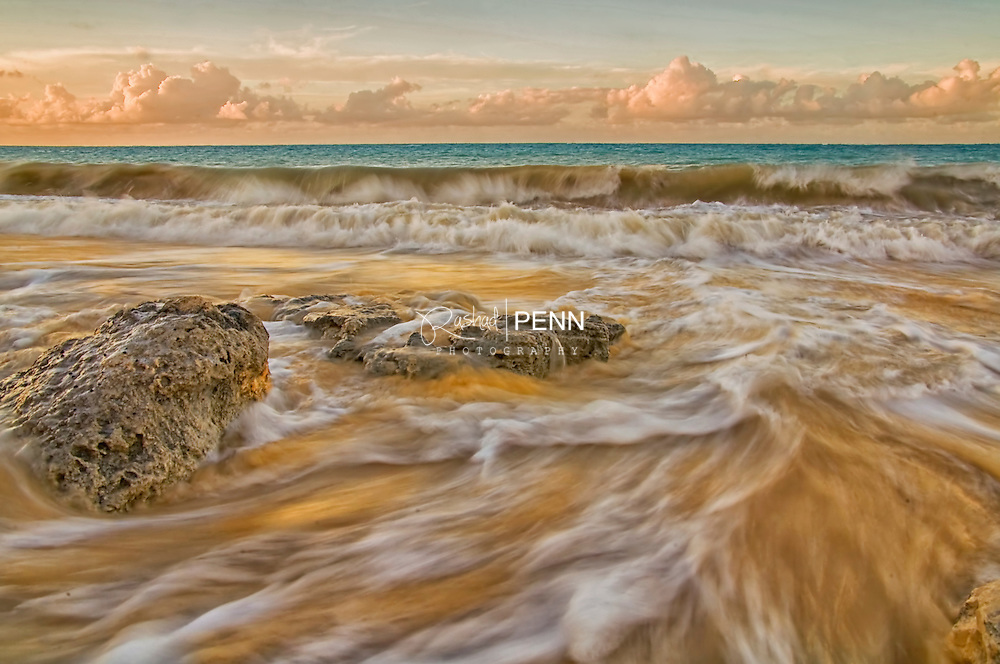Continuous Waves breaking on the beach on Caves Beach New Providence, The Bahamas