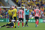 referee Andre Marriner gives a yellow card to Oriol Romeu of Southampton for fouling Etienne Capoue of Watford. Barclays Premier League, Watford v Southampton at Vicarage Road in London on Sunday 23rd August 2015.<br /> pic by John Patrick Fletcher, Andrew Orchard sports photography.