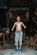 Shopkeeper's workout . Beijing, China