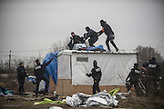 March 1, 2016 - Calais, France -<br /> <br /> Destruction Of Calais Jungle Camp Continues<br /> <br /> A police officer grapples with a woman holding a knife after she threatened to cut her wrist during clearance of the 'jungle' migrant camp on March 01, 2016 in Calais, France. Authorities return to clear migrant shelters from more parts of the 'Jungle' migrant camp in Calais and try to move people to shipping containers on another part of the site. French demolition teams began dismantling huts yesterday. Resistance is expected to continue and overnight riot police fired teargas at migrants who were throwing stones. A court ruling on Thursday approved a French Govt plan to clear part of the site. Authorities say approx 1,000 migrants are to be affected out of 3,700 people - many of them refugees from Syria and Iraq - who are thought to live in the camp. Mayor of Calais Natacha Bouchart has demanded the closure of the site for several weeks following several recent clashes with police <br /> ©Exclusivepix Media
