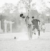 Young men play cricket in Lucknow, Uttar Pradesh, India