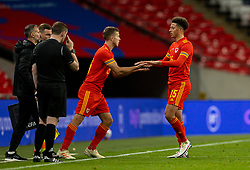LONDON, ENGLAND - Thursday, October 8, 2020: Wales' Ethan Ampadu is replaced by substitute Will Vaulks during the International Friendly match between England and Wales at Wembley Stadium. The game was played behind closed doors due to the UK Government's social distancing laws prohibiting supporters from attending events inside stadiums as a result of the Coronavirus Pandemic. England won 3-0. (Pic by David Rawcliffe/Propaganda)