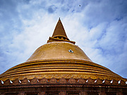 10 JULY 2018 - NAKHON PATHOM, THAILAND: Phra Pathom Chedi in Nakhon Pathom. Nakhon Pathom is about 35 miles west of Bangkok. It is one of the oldest cities in Thailand, archeological evidence suggests there was a settlement on the site of present Nakhon Pathom in the 6th century CE, centuries before the Siamese empires existed. The city is widely considered the first Buddhist community in Thailand and the nearly 400 foot tall Phra Pathom Chedi is considered the first Buddhist temple in Thailand.     PHOTO BY JACK KURTZ