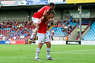 Keshi Anderson of Swindon Town celebrates with Jerry Yates of Swindon Town as he scores the opening goal 0-1 during the EFL Sky Bet League 2 match between Scunthorpe United and Swindon Town at Sands Venue Stadium, Glanford Park, Scunthorpe, England on 3 August 2019.