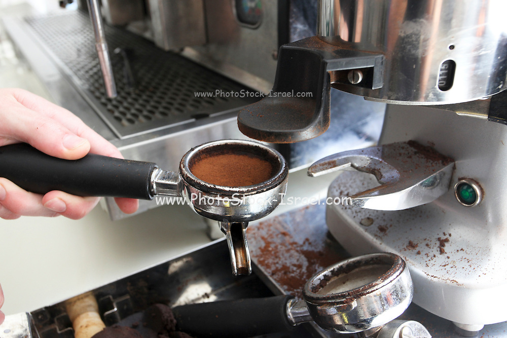 Man using coffee machine to make coffee Freshly ground coffee