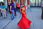 """14 FEBRUARY 2010 - PHOENIX, AZ: A girls spins while warming up before performing at the Chinese New Year celebration in Phoenix, AZ. This marks the Chinese """"Year of the Tiger."""" The Chinese New Year Celebration at the COFCO Chinese Cultural Center in Phoenix attracted thousands of people. The celebration featured traditional Chinese entertainment and food.  PHOTO BY JACK KURTZ"""